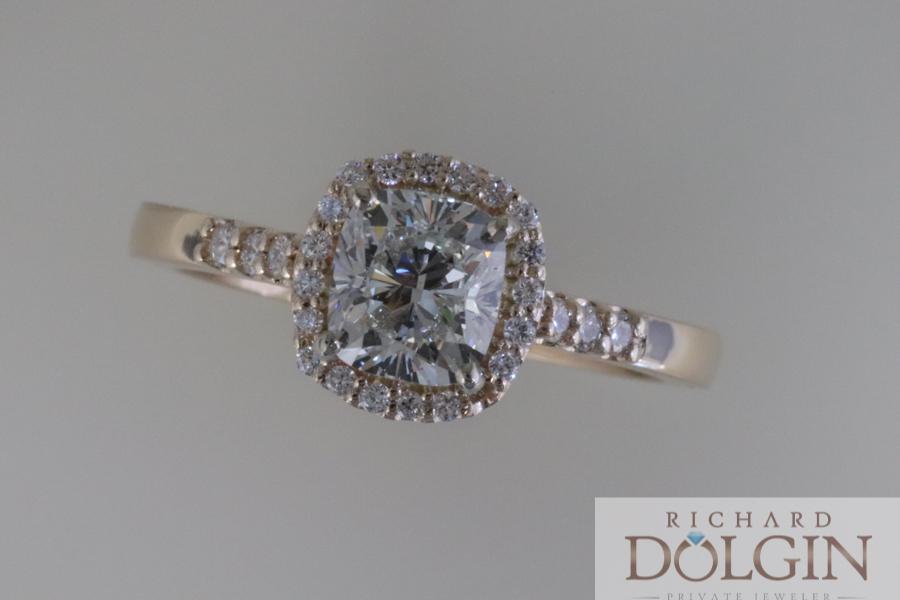 Cushion cut diamond with halo engagement ring