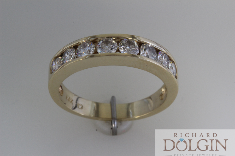 Channel set yellow gold wedding band
