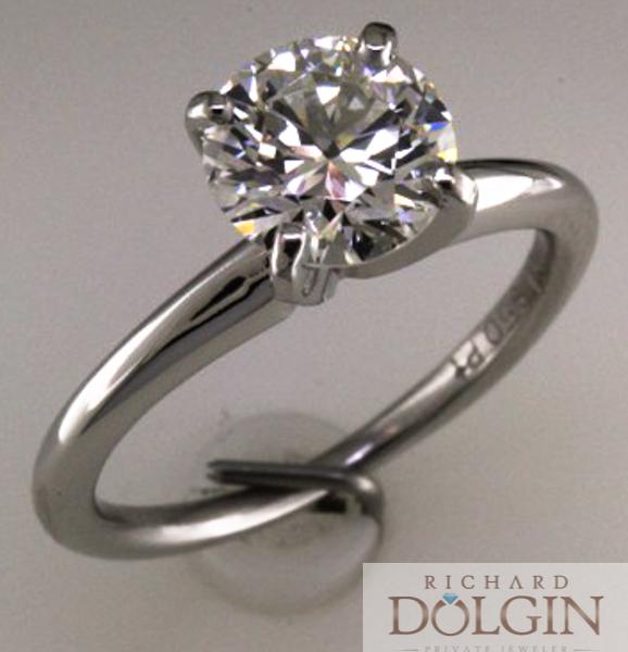 Solitaire round brilliant engagement ring