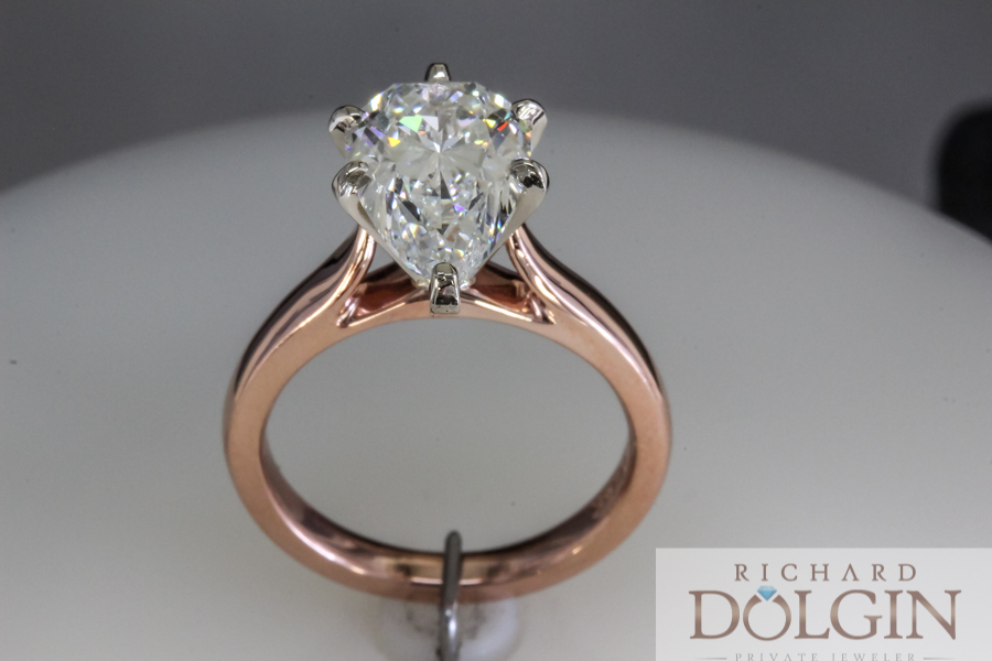 Rose gold pear shape diamond engagement ring