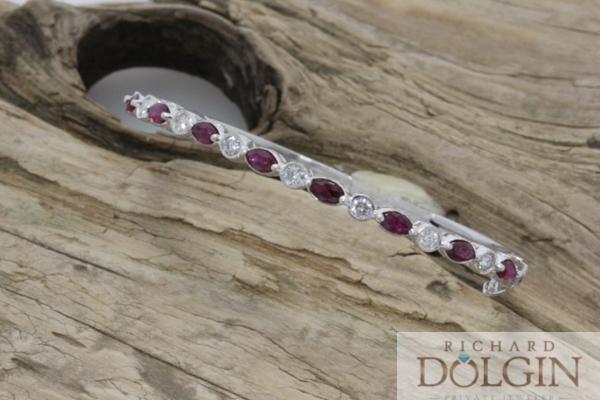 Hinged ruby and diamond bangle bracelet