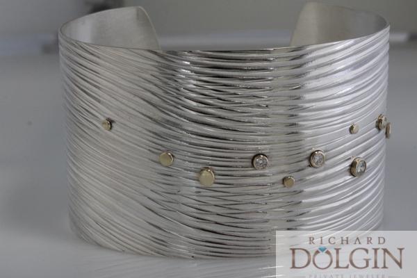 Wide wave pattern bracelet with diamonds