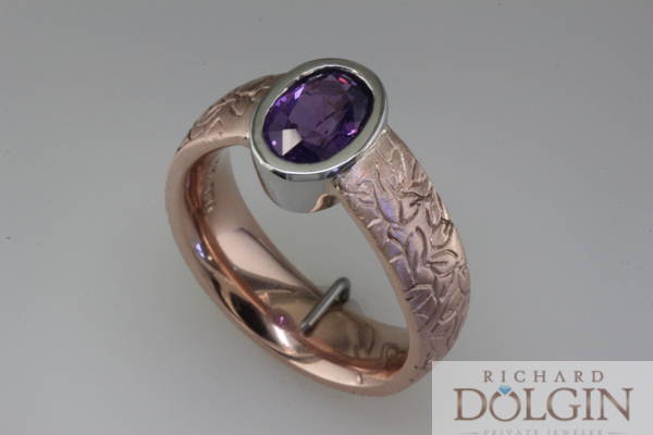 Bezel set purple sapphire in rose gold