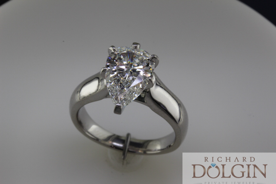 Pear shaped diamond in platinum cathedral