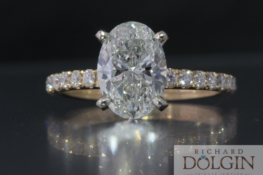 Oval diamond engagement ring with diamond band