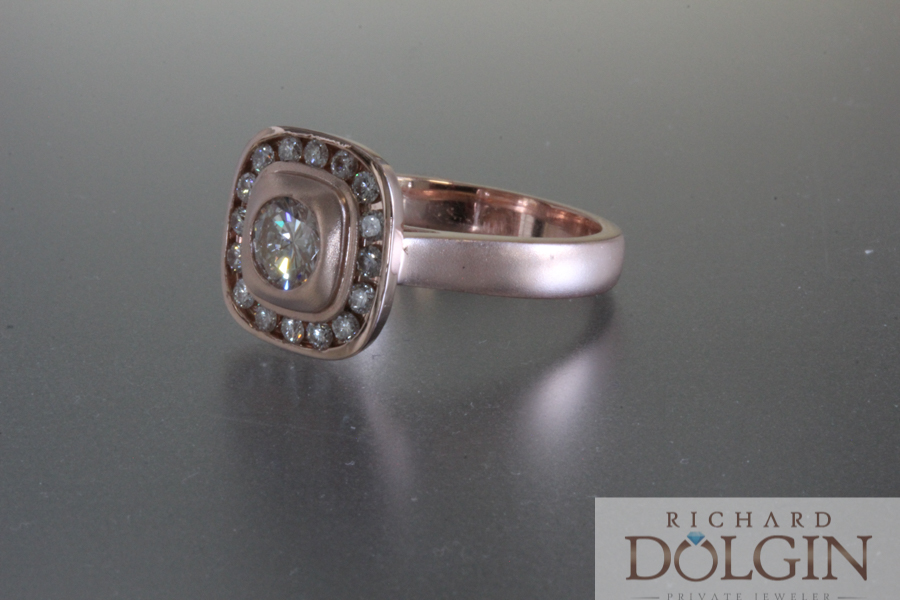 Diamond halo in rose gold engagement ring
