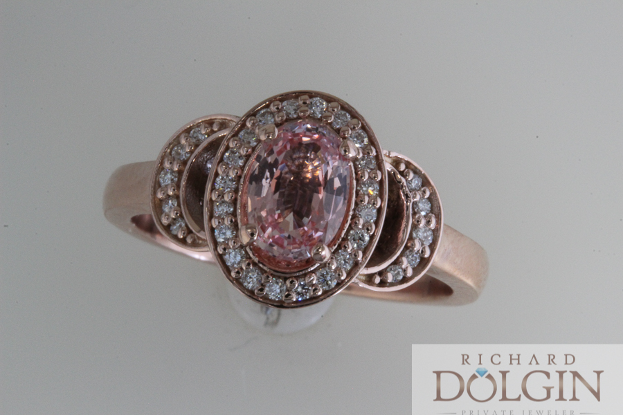 Peach sapphire set in rose gold engagement ring