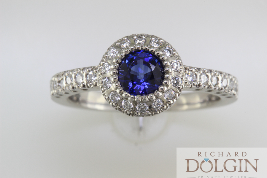 Blue sapphire in halo platinum engagement ring