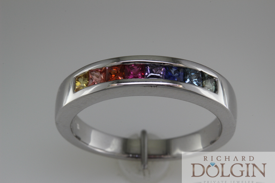 Sapphires of many colors in white gold band