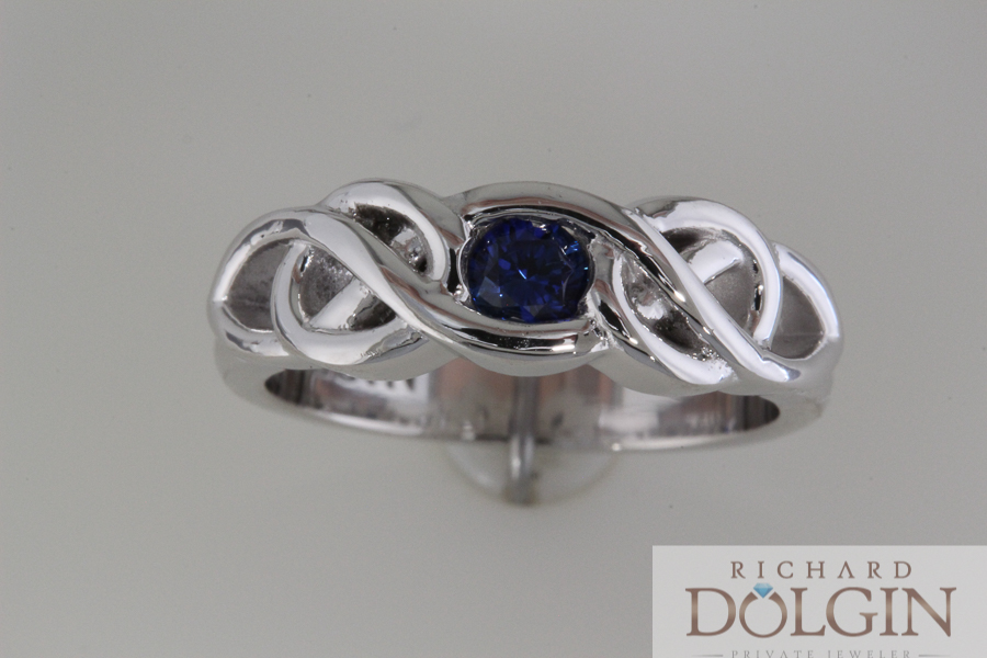 Blue sapphire in Celtic design wedding band
