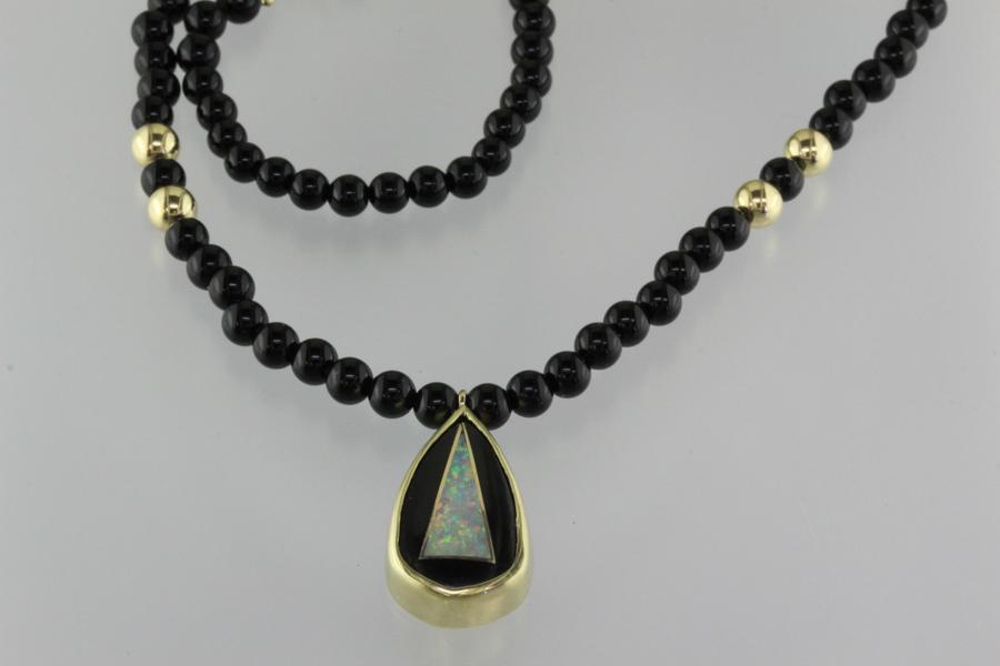 Intarsia pendant on onyx bead necklace