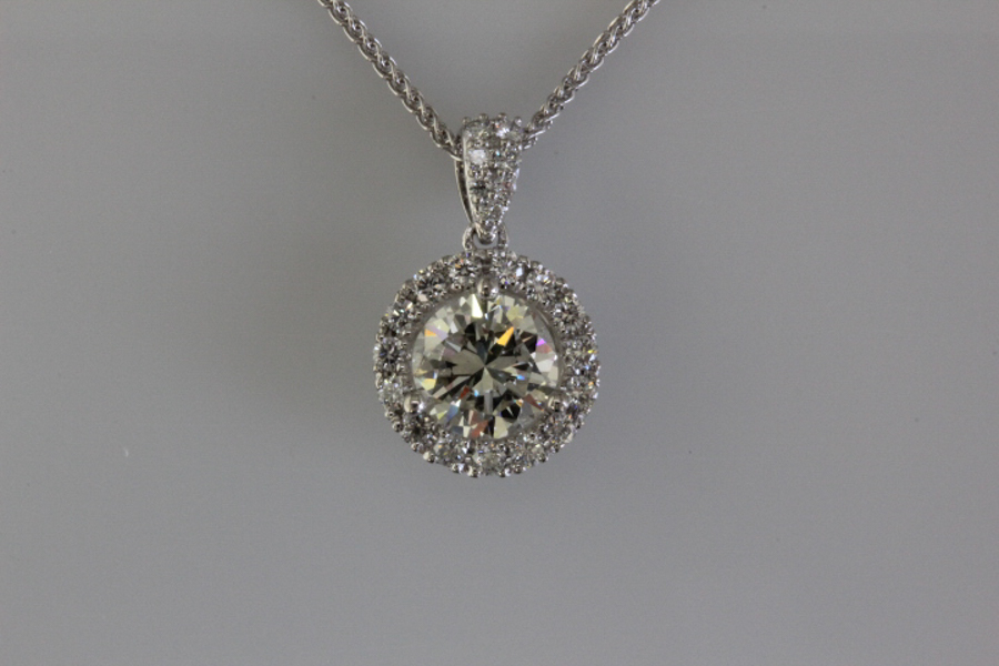 Diamond solitaire with halo pendant