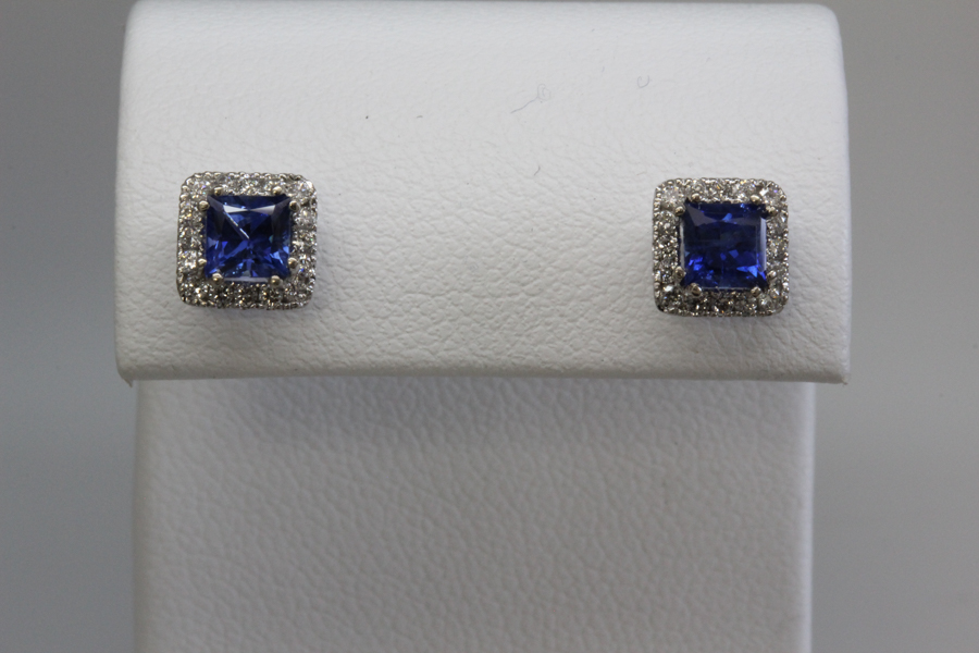Blue sapphire in diamond halo earrings