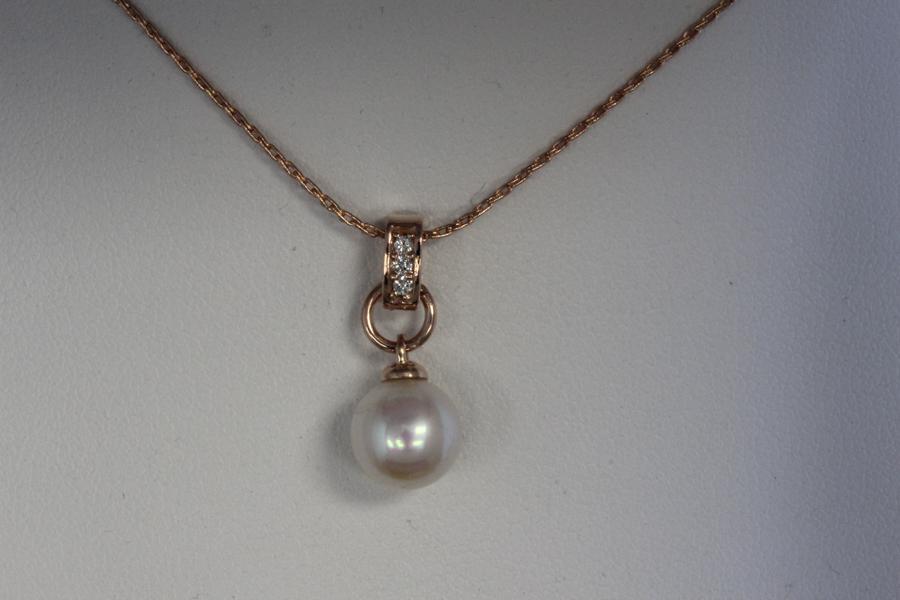 Pearl and diamond pendant