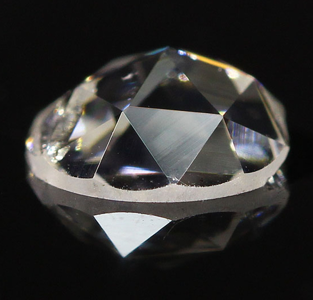Rose cut diamond with flat bottom and faceted apex.
