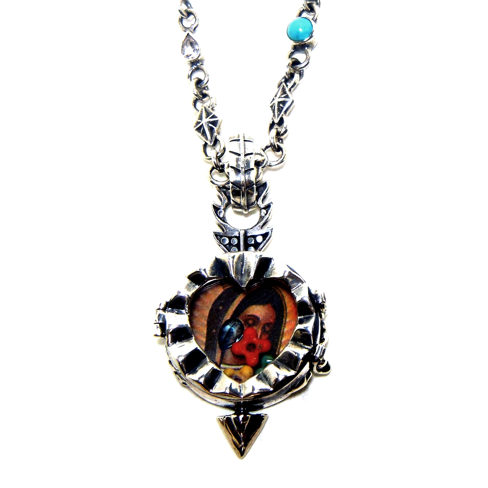 Adamo Fortuno heart locket necklace.
