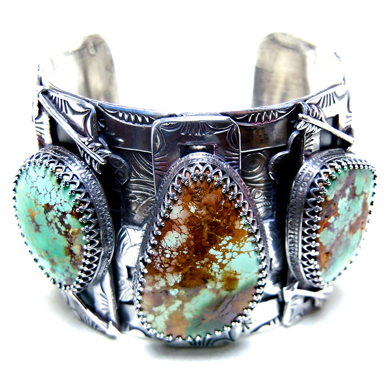 Cuffs:  Sterling silver cuff bracelets.