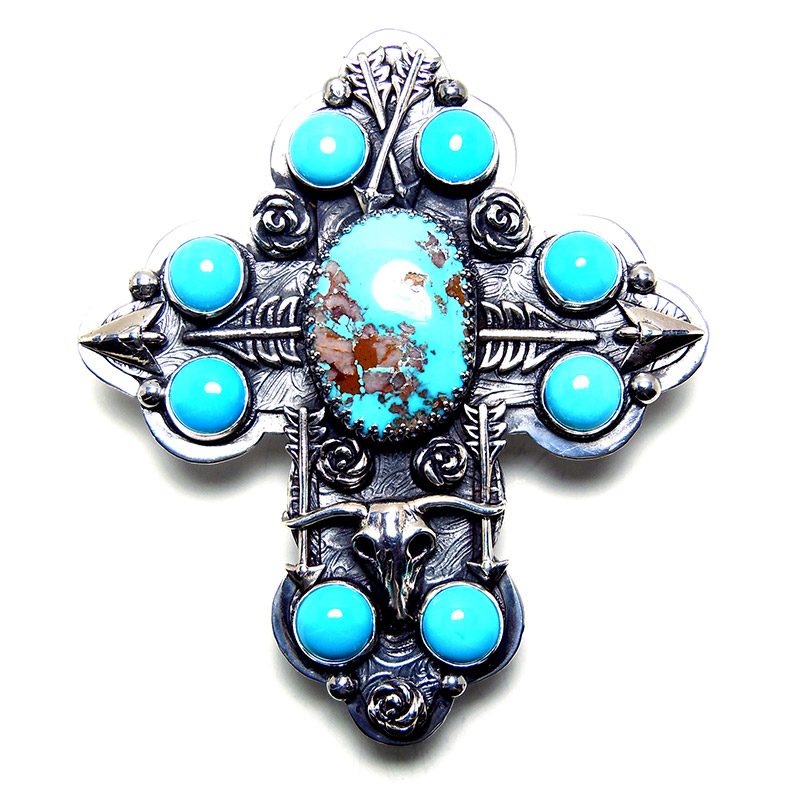 Crosses:   Sterling silver crosses set with turquoise, D&A icons and semi-precious stones.