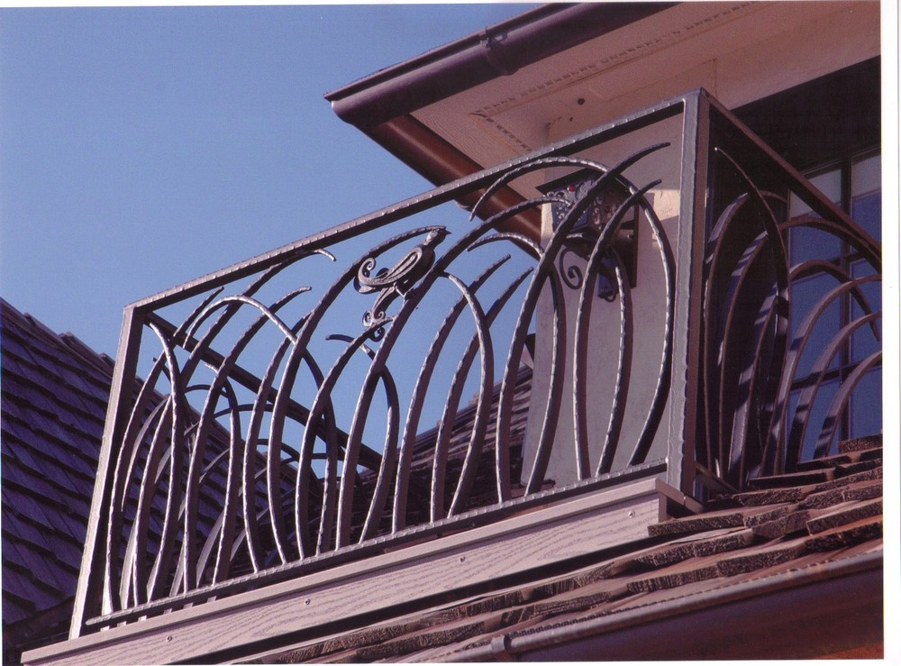 James and Julie Welch Estate Grand Lake, OK Forged Bird and Reed Balcony Railing
