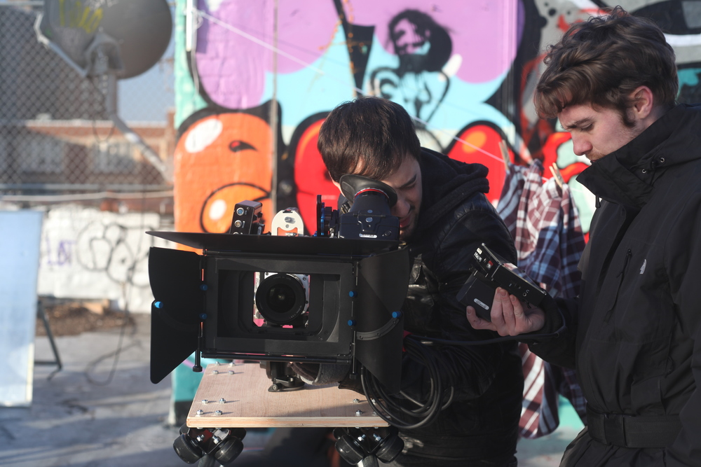 "Director/DP Robert Kolodny behind the Phantom Miro with A/C Ian Hoban while shooting the final scene of ""Fly on Out"""