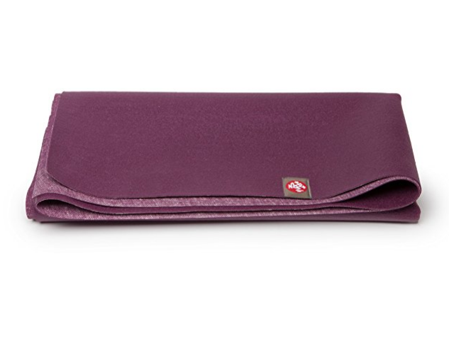 Travel Yoga Mat - My favorite travel yoga mat by Manduka. I traveled with this mat for 6 months. It's lightweight, easy to clean, and comes in bright colors.