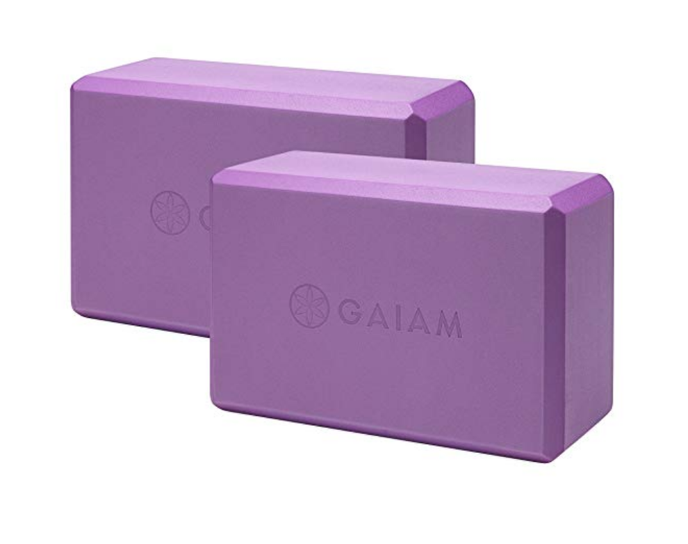 Foam Yoga Blocks - These foam blocks are great for beginners because they're lightweight yet have a high density to them, so they provide the support needed.