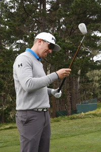 Hunter Mahan inspects a niblick