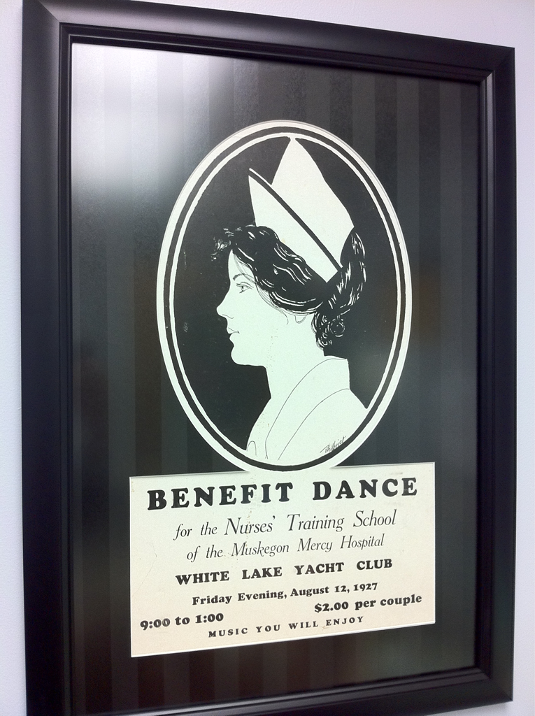 "I work next door to the nursing administration office, which was recently renovated. On the wall hangs an old poster advertising a ""Benefit Dance"" in August 1927 for the Nurses' Training School of the Muskegon Mercy Hospital.     It sounds like I missed a good time!"