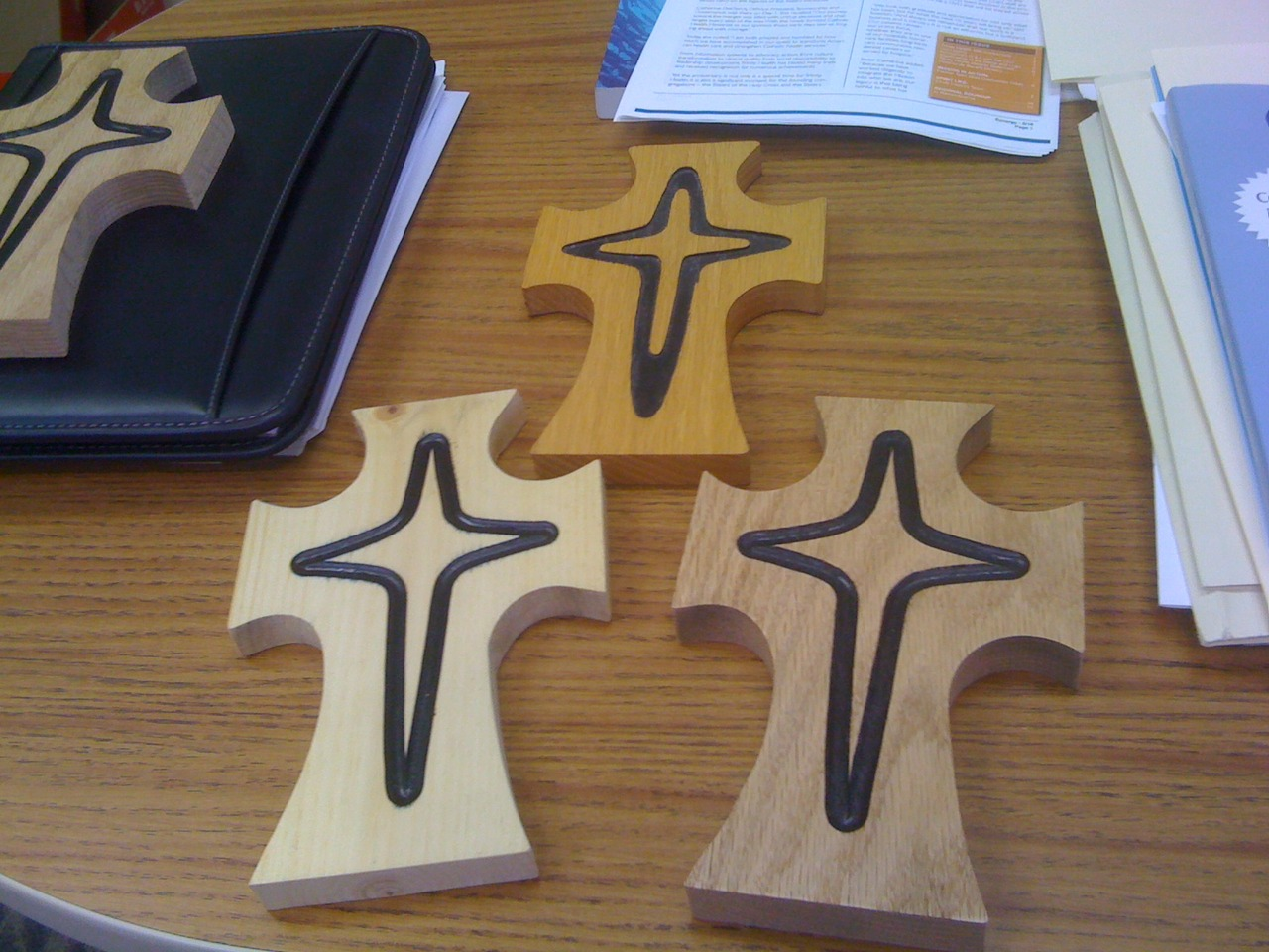 "Should we go with the oak or pine? I'm leaning toward the oak.   BTW, a Sister of Mercy recently shared with me the symbolism behind this ""Mercy Cross"" design.     Catherine McAuley experienced many tragedies growing up and found much meaning in Christ's suffering on the cross.   She spent many years living with a protestant family who did not allow crucifixes in the home. Instead, Catherine focused her prayer on a door, specifically the cross implied by the molding.   In the Mercy cross, the smaller cross within the larger cross symbolizes our suffering in the context of Jesus' suffering and paschal mystery.      Purchase your own Mercy Cross here ."