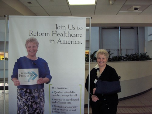 This is my mentor. She's beside herself.   What's with the sign, you ask? It's about  health care reform in the United States .      We   Must  Find A Way  .