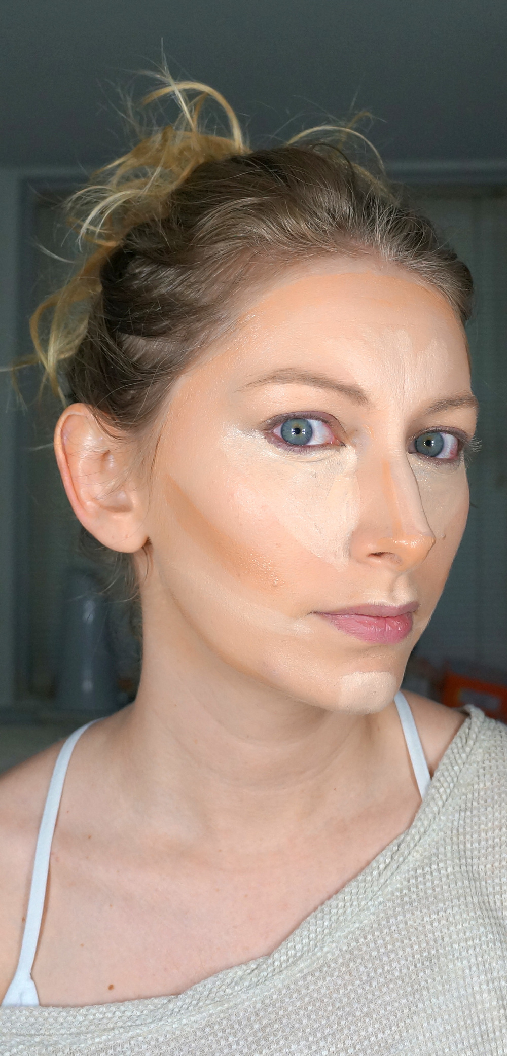 Apply a concealer or a foundation a few shades lighter than your skintone to areas you want to project forward. These areas are under your eyes, down the center of your nose, the cupids bow of your upper lip, above your jawline, and your chin.  Next, apply a foundation a few shades darker than your skintone to areas you wish to recede. These areas are the hollows of your cheeks, down the sides of your nose, your temples and across the hairline on your forehead, under your jawline, and a smidge under your bottom lip.