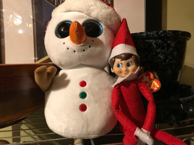 Shawn Anderson Elf with snowman.jpg