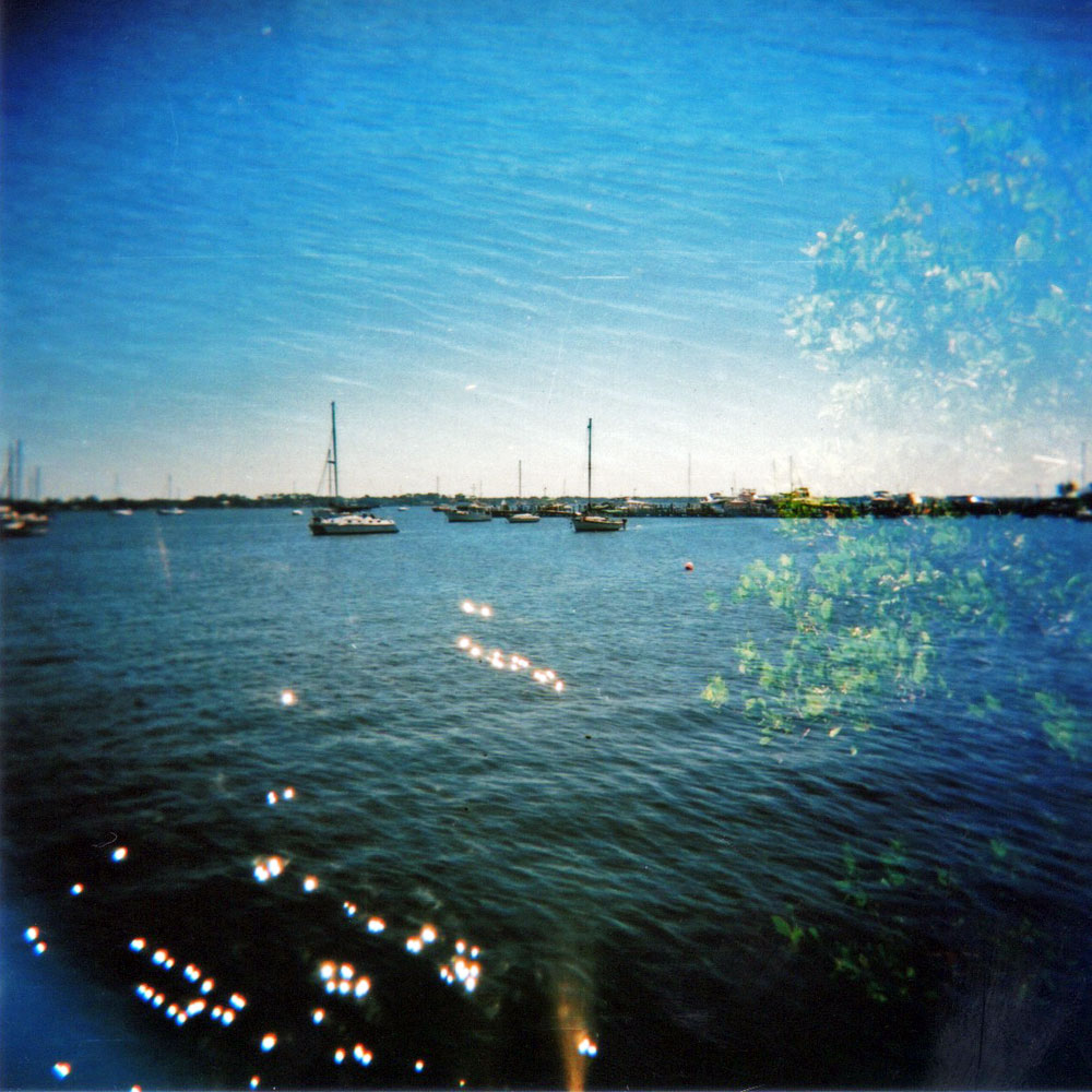 apfsampaio :        . indian river . cocoa village . florida   © Ana Paula Sampaio    Flickr  |  Facebook  |  Twitter     Holga 120 + Fuji Superia 400 + double exposure