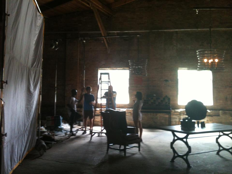 Setting up a shot in the spacious old cotton warehouse.