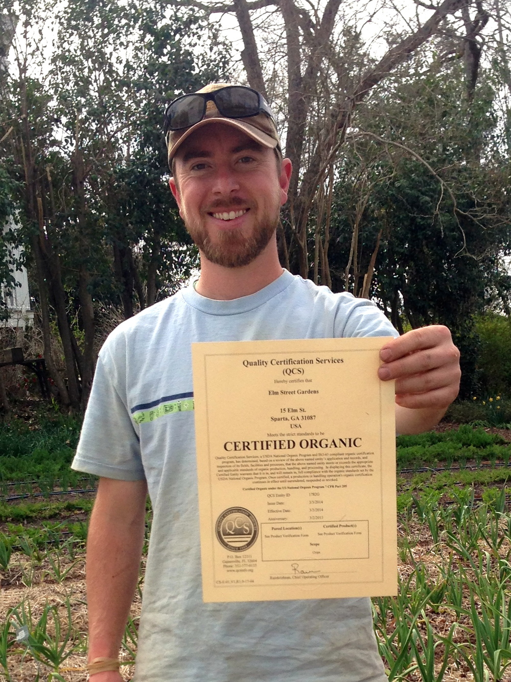 Outstanding in his field:  Jim Fraser shows off the confirmation of Elm Street Gardens' new status.