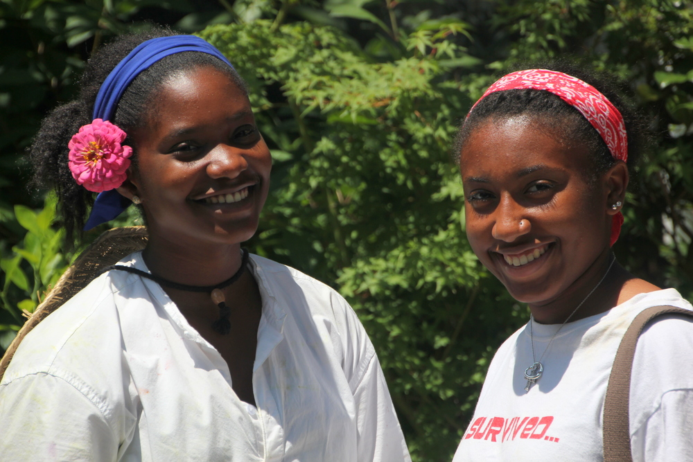 Hard working girls share a smile at the end of the day.
