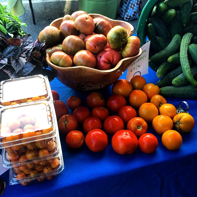 Elm Street Gardens tomatoes call to customers at the Morningside Farmers Market in Atlanta on Saturdays.