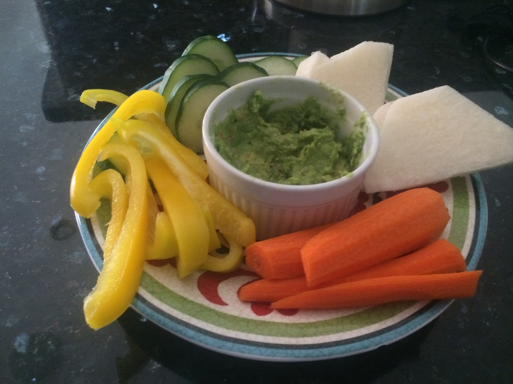 Snacks - vegetables with salted avocado, along with raw nuts