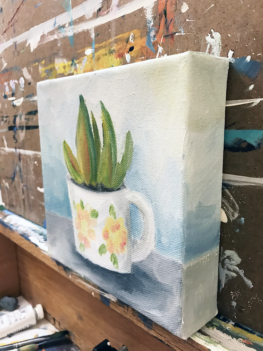 side profile of succulent and coffee cup painting