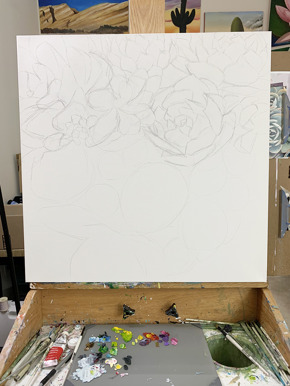 Work in progress - succulent garden painting on easel. First step: Drawing it out.