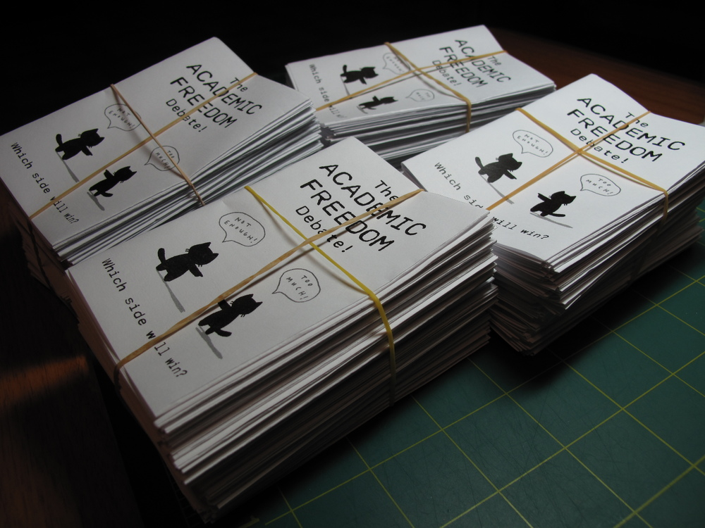 A bunch of mini-zines printed, folded, and ready to get distributed to the audience of a panel on academic freedom at the University of Winnipeg. November, 2009.