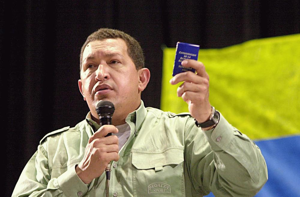 Chávez holds a miniature copy of the 1999 Venezuelan Constitution at the 2005 World Social Forum held in Brazil. (photo and caption from Wikipedia)