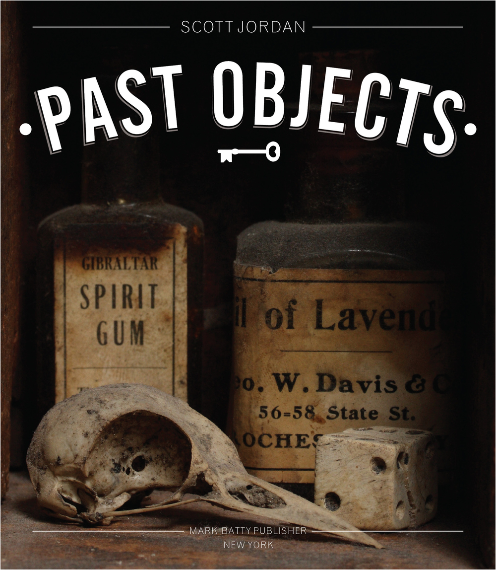 "Past Objects       (Mark Batty Publisher, 2010)     A document of ""digger"" (amateur archeologist) Scott Jordan's collection of treasures unearthed from New York City's construction sites. Throughout the book, there's an attempt to mix up the layers of history through a variety of fonts and styles taking influence from everything from Victorian advertising to Sotheby's catalogs. The cover is an amplified version of what you find when you crack the book open.  To see the full book design  click here ."