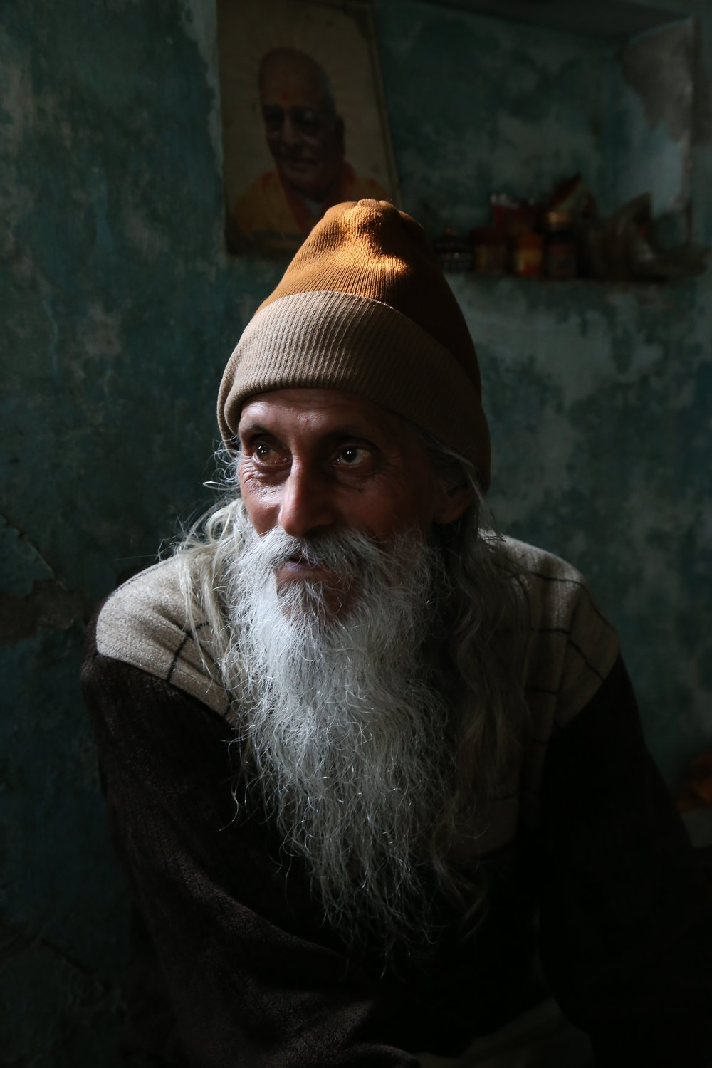 "Michelle Larson -  My curious nature keeps me traveling to exotic destinations around the world. What most fascinates me is the people. I am so curious about how we are different and how we are the same. I want to delve into the unknown with wild abandon and come out changed. This photo is of a Swami who I met in Rishikesh, India. He offered me tea and said… ""this is not tea, this is my love."""