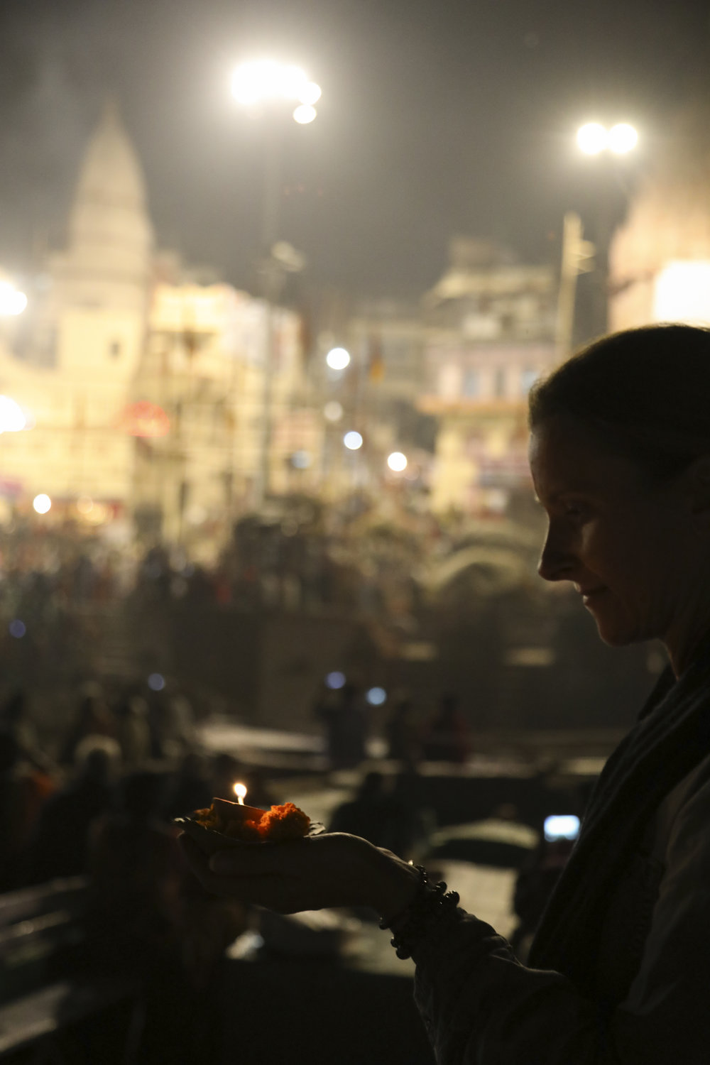 Julie Cimpko -   I was full of CURIOSITY the moment I landed in Varanasi, India's holiest city. The sites, smells, colors, rituals are truly like no other place in the world…certainly not for the faint-hearted. Michelle took this photo of me as I was stepping down from the boat to give an offering to the Ganges amidst hundreds of people and the puja fire ceremony behind me. It felt as if I were transported to another time.