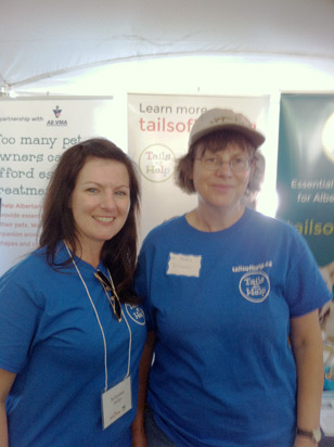 volunteer staff at the tails of help booth for pets in the park