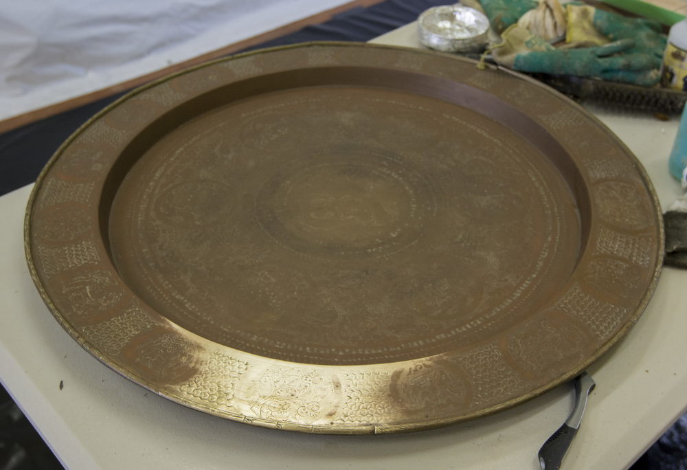 Lance stripped a weird lacquer off this old brass plate from Thailand. This had actually been in a Thai embassy in Australia, moved to the sulfur filled air of Rotorua to add some corrosion to the bare bits. Then finally met us where it was saved.