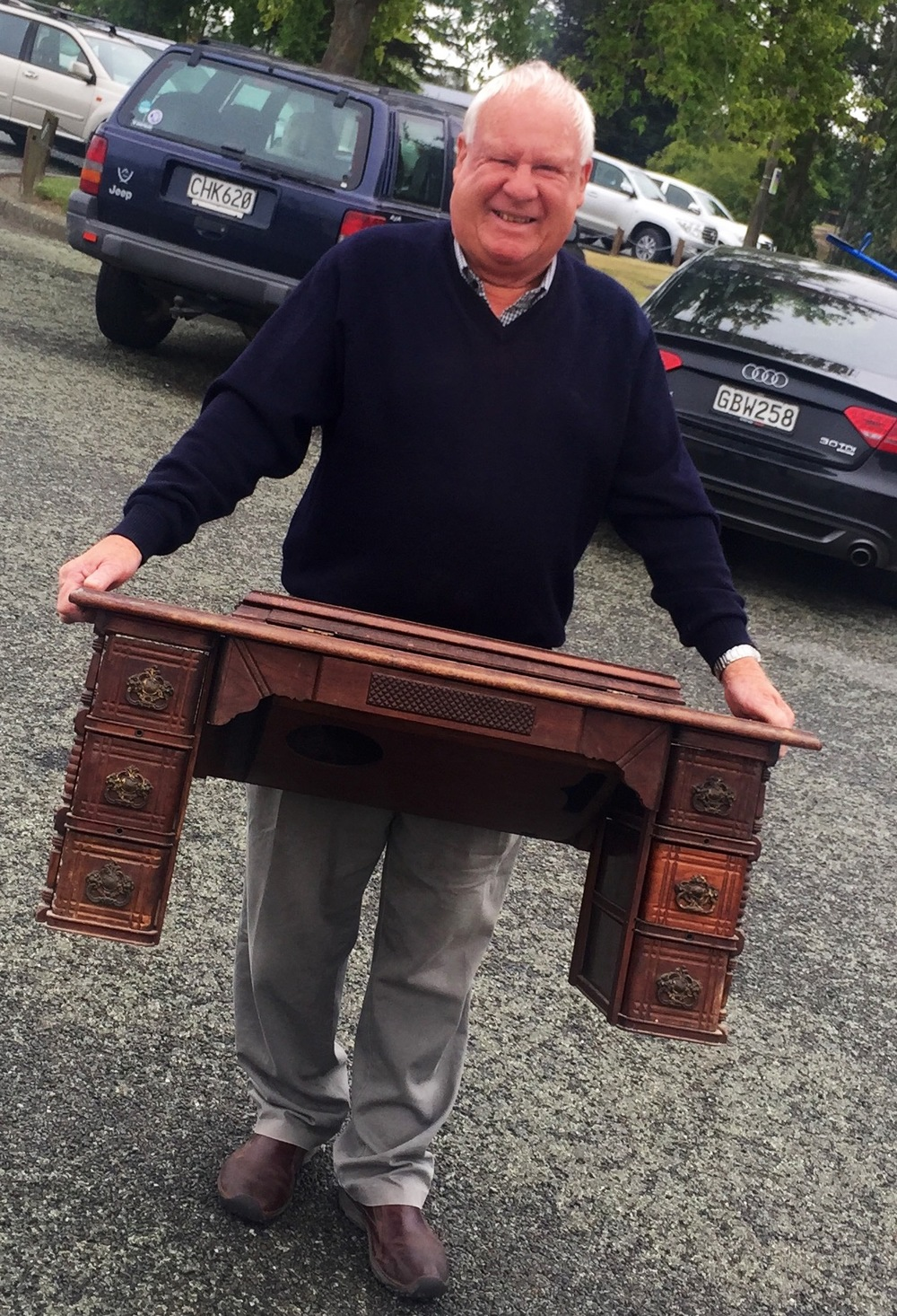 This is a sowing machine cabinet that Dorri stripped the middle right draw of,this man appears to be pleased with the result.