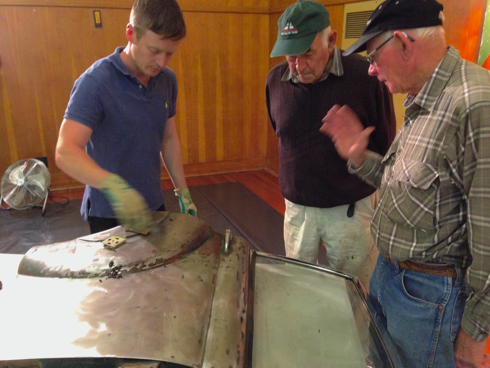 Lance showing two gentlemen in Invercargill how to strip a daimler car door. (We have one of those :0)