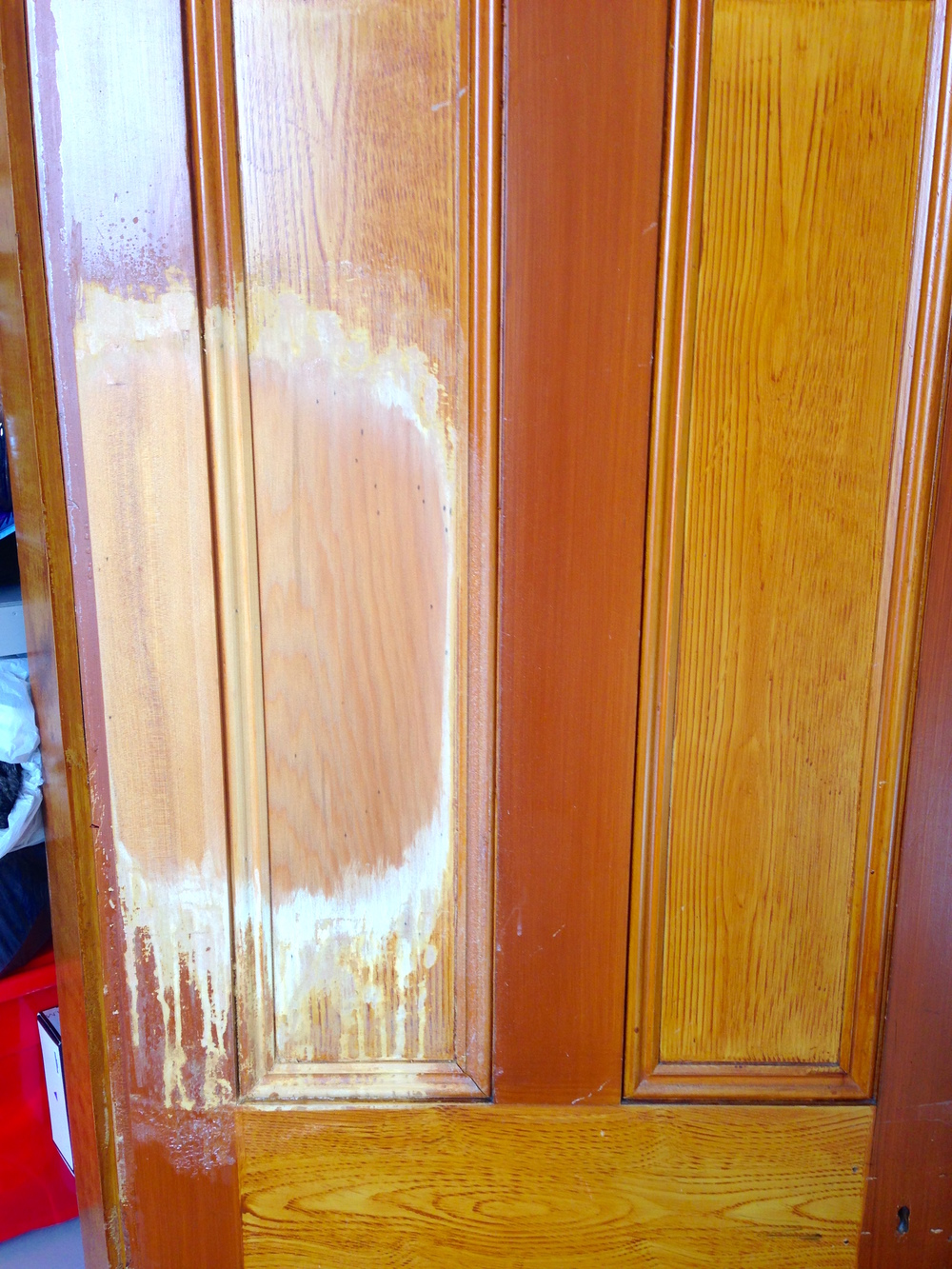 Here is a rather interesting project, this door has had a fake wood grain put on top of it to make it look like oak and they do this by spreading out a leadish clay to blot out the original wood (Its Kauri by the way.) and than brush out the new grain to look like oak as back in the gold rush days it was cheaper to get a premium Kauri door and paint a fake grain on it than buy an oak door.